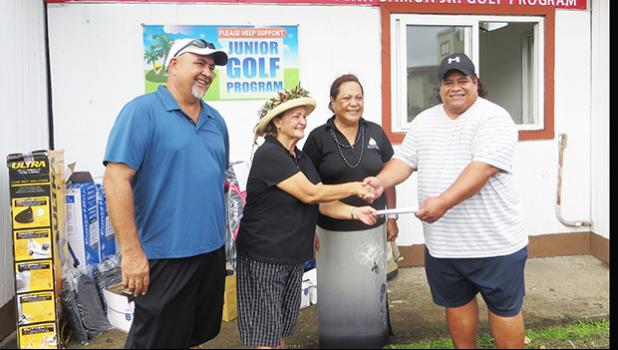 President of the Tina Drabble Junior Golfer's Foundation, Taalolo Chande Lutu-Drabbl, handed over the check of $3,000 and assorted golf equipment to assist with the 5 junior golfers and their coaches to attend the Galaway World Junior Golfer's Program in San Diego, California this summer. John Mitchell and Peter Young received it on behalf of the Junior Golfers Association.  [photo: Leua Aiono Frost]