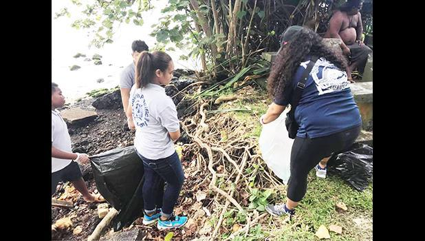 Students during a clean up project along the Pala Lagoon shoreline in Lions Park