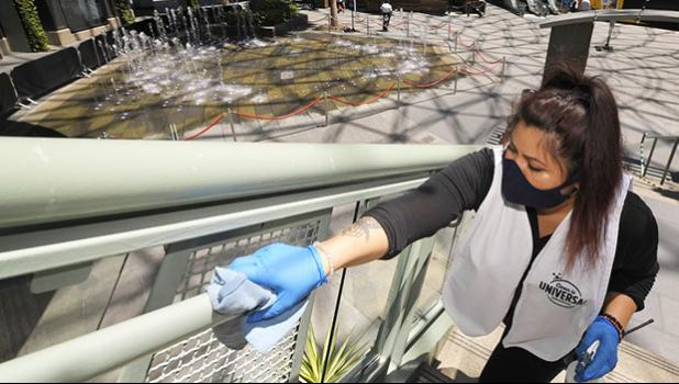 Woman cleaning a stair railing