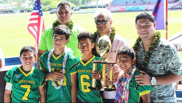 JPS Leone Lions Coach of the Year Oakland Salave'a and the Champions of the Division 2, Leone Lions. [photo:EM]