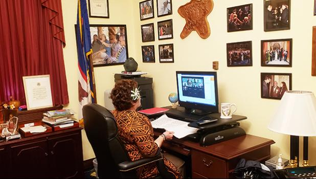 Aumua Amata in her D.C. office at computer during virtual forum
