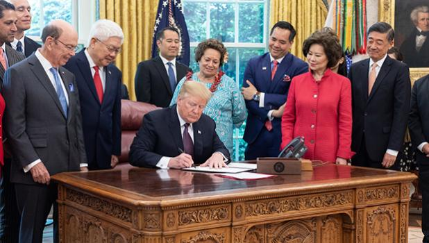 Aumua Amata and others watching Trump sign Executive Order