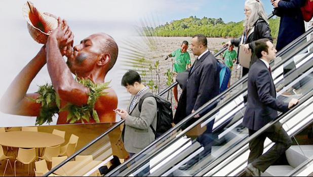 Visitors use an escalator past a poster featuring the Fiji Islands on the opening day of the COP 23 United Nations Climate Change Conference on November 6, 2017 in Bonn, Germany