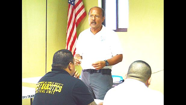 Ernest Haleck, a certified Firearms and Tactics Instructor from Honolulu, during yesterday's official opening of a training session held at the OMV conference room and aimed at preparing local cops to be armed. [photo: AF]
