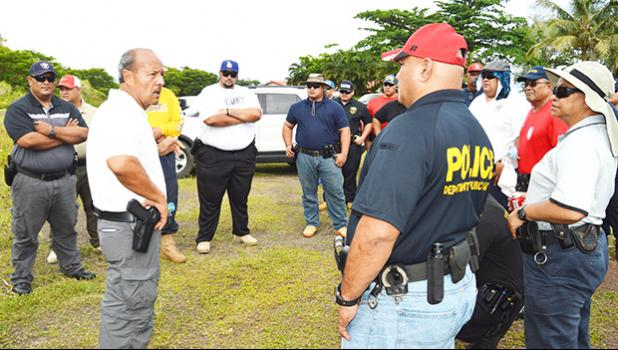 Ernie Haleck (middle) - the lead instructor in Firearms and Tactics for the National Tactical Officers Association (NTOA) and DPS in American Samoa - briefing local police officers last week, on the last day of a 2-week training course that certifies them to carry weapons. See story for details.  [photo: AF]