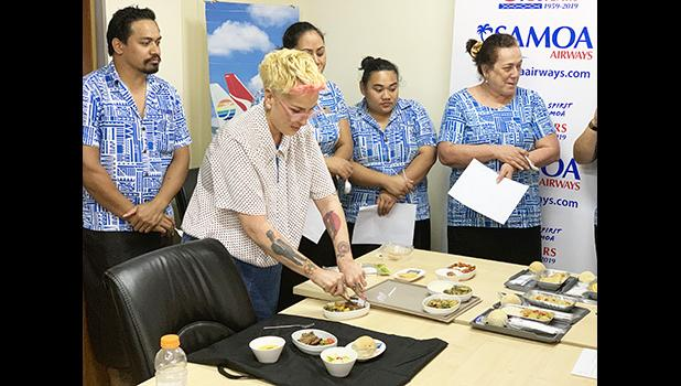 "Samoa Airways staff members seeing samples of the airline's new ""farm to plane"" menu"