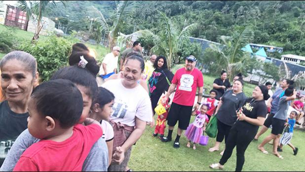 The large crowd lining up for fun and games at the Halloween Harvest Carnival hosted by Maoputasi Rep. Vesiai  Poyer Samuelu and  family.