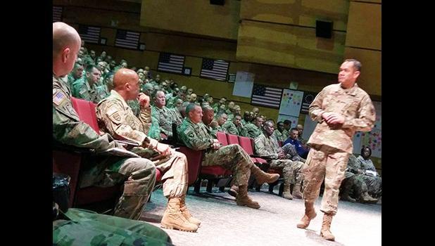 Retired Command Sergeant Major Charles Tobin (standing, right)