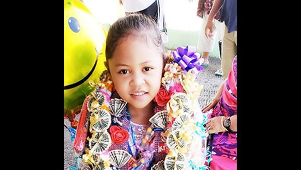 Daenerys Vitolio after her K-5 graduation