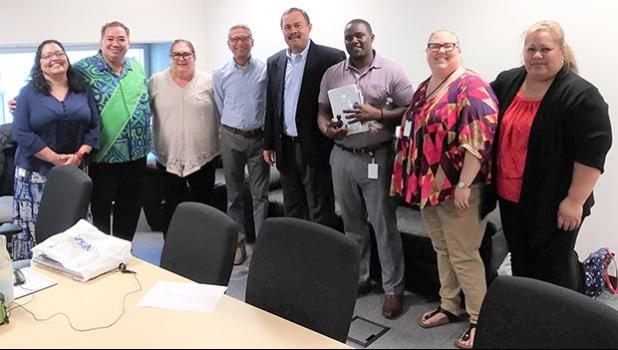 USDA Western Regional Administrator Jesus Mendoza (4th from left) with DHSS director Muavaefaatasi John E. Suisala (4th from right) and his staff in