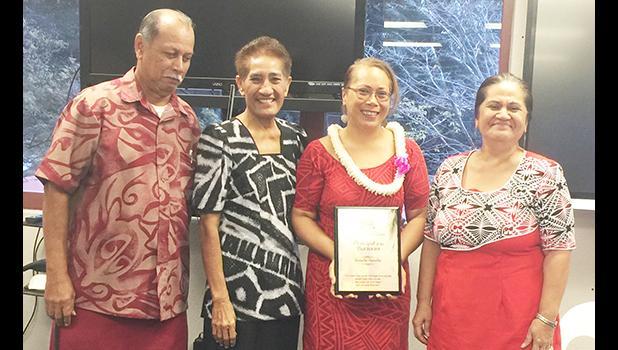 Tafuna High School principal Tutuila Togilau (second from right), Philo Jennings (far left) and Faaui Vaitautolu (second from left).