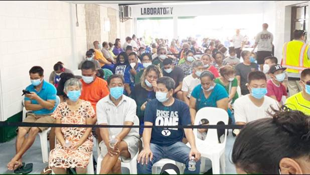 A crowd with masks at DoH