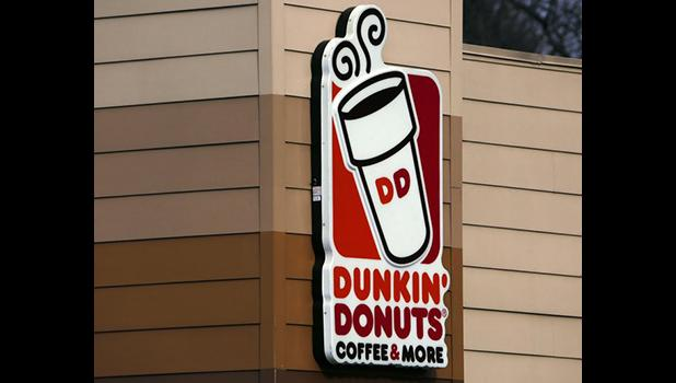 This Jan. 22, 2018, file photo shows the Dunkin' Donuts logo on a shop in Mount Lebanon, Pa. Dunkin' Donuts says a story and clickable coupon being shared widely online that offers free boxes of doughnuts to celebrate its anniversary is false. (AP Photo/Gene J. Puskar, File)