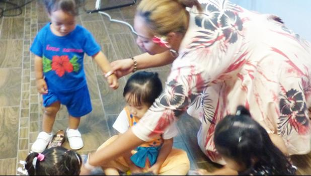 DOH Helping Hands Madelyn Aiava Aiono with children