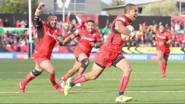 Team mates celebrate as Tonga's William Hopoate scores [Photo: Photosport vis RNZI]