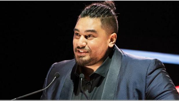 A slightly teary-eyed Kings accepting his second award of the night - Best Pacific Urban Artist. [Photo: Hannah Rolfe / Topic via RNZI]