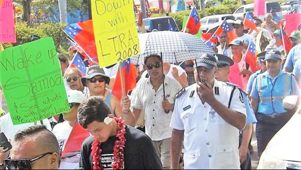 There was a heavy police presence in Apia as about 200 people turned out to protest against land laws. [Photo: RNZI / Autagavaia Tipi Autagavaia]