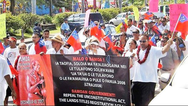 About 200 people marched through Samoa's capital, Apia, on Saturday, protesting against land laws. [Photo: RNZI / Autagavaia Tipi Autagavaia]
