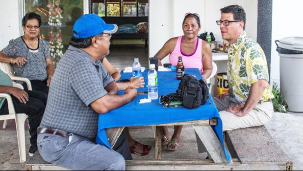David Henkin (right) meets with Tinian residents