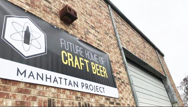 Photo of The Manhattan Project Beer Company building and sign