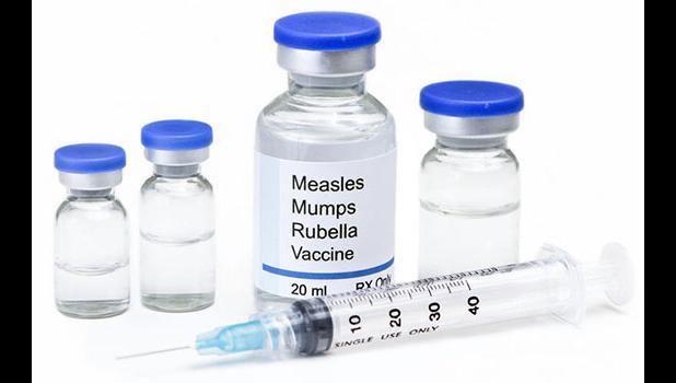 MMR vaccine bottles and needle