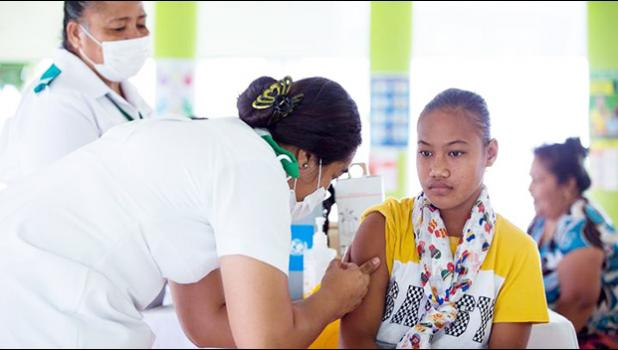 A girl receiving a vaccine