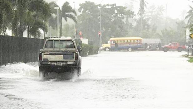A flooded road in Samoa's Pesega