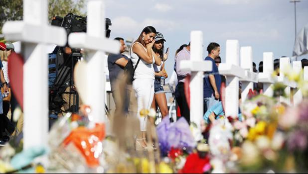 People visit a makeshift memorial in El Paso, Texas