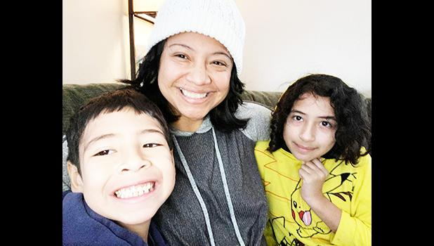 Epifania Rapozo (middle) and her two children