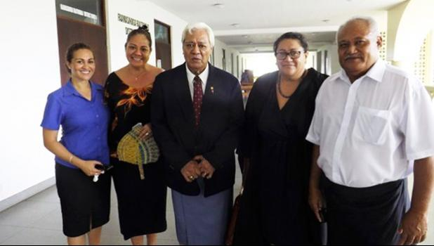 Faamauslil Moli Malietoa leaving courthouse surrounded by family members