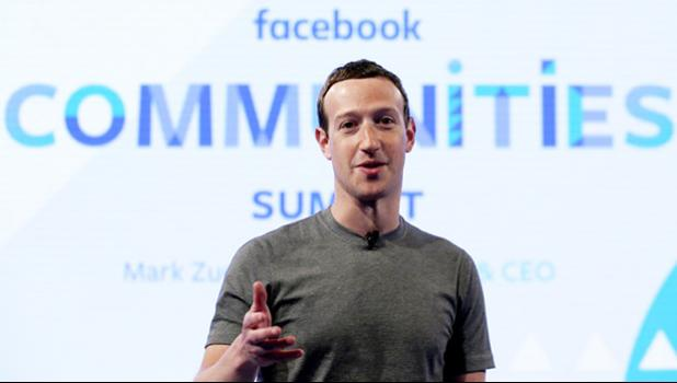 "In this Wednesday, June 21, 2017, file photo, Facebook CEO Mark Zuckerberg speaks as he prepares for the Facebook Communities Summit in Chicago. Facebook is once again tweaking the formula it uses to decide what people see in their news feed to focus more on personal connections and take the spotlight off brands and news articles. Facebook says it will highlight posts people are most likely to engage with and make time spent on social media more ""meaningful."" (AP Photo/Nam Y. Huh, File)"