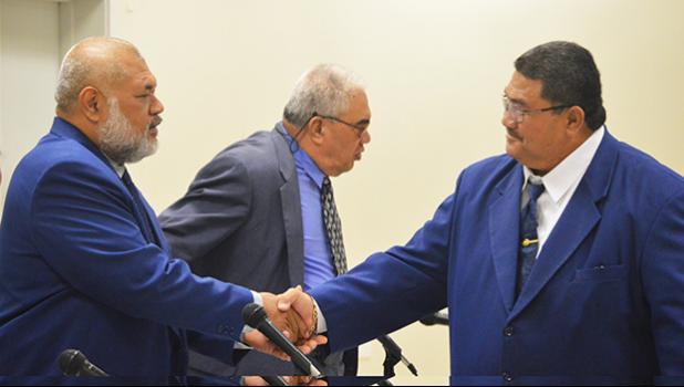Fetu Fetui Jr shaking hands with Rep. Sataua Dr. Mataese Samuelu