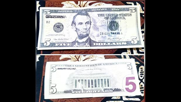 Photos of back and front of fake $5 bill.