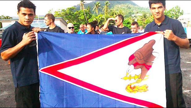 Two local fighters representing American Samoa during the 2018 Oceania Youth Boxing Championships, which was also a Qualifier Championship for the Youth Olympics Games in Argentina this year, Falaniko Tauta and Jolando Taalo, posing with the American Samoa flag.