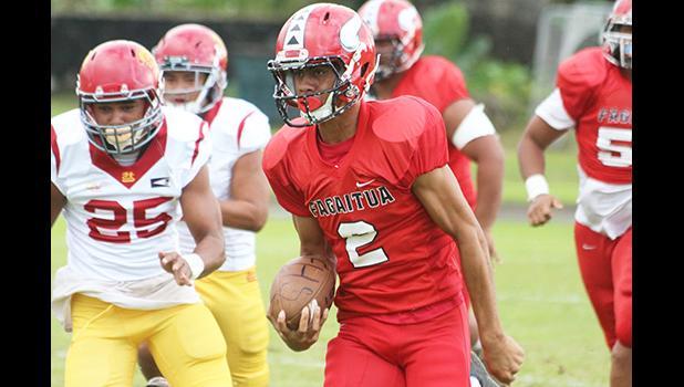 Faga'itua Vikings quarterback Fitu Amata Jr. breaking