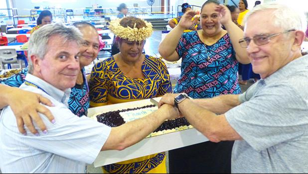 """Local government staff, including Fa'aui Fano Lefotu, prepared a farewell luncheon Wednesday afternoon for US Federal Emergency Management Agency (FEMA) officials, as the Disaster Recovery Center, located inside the DYWA Pago Pago Youth Center, officially closes tomorrow.  Pictured are two FEMA officials, with local staffers, cutting the cake — which read """"Thank You FEMA."""" Local government officials, who assisted FEMA officials with translations and other duties prepared the delicious cake. [photo: Leua Aio"""