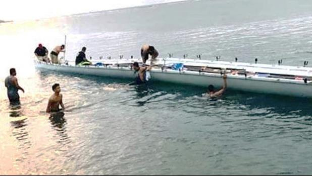 Fagaalu's Fetu ole Afiafi crew in the water with the boat