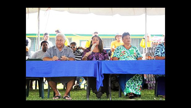 FFAS President Faiivae Iuli Alex Godinet, left, with Vice-President and FIFA Council member Sandra Fruean, middle, and FFAS executive member Saili Ott during the closing ceremony of the 2016 FFAS Private Elementary Schools Soccer League at Kanana Fou on Tuesday, Nov. 22, 2016.  [FFAS MEDIA/Brian Vitolio]