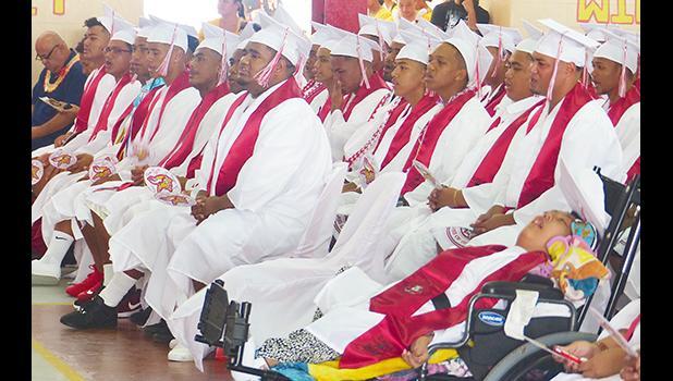 Several male graduates of Faga'itua HS Class of 2019