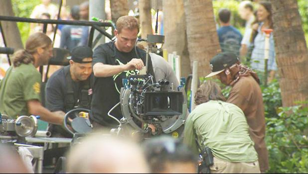 A film crew working on the streets of Honolulu