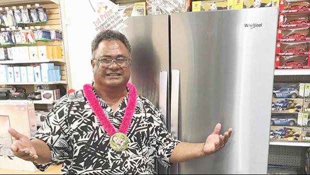 Talavave Maae with the Whirlpool refrigerator he won.