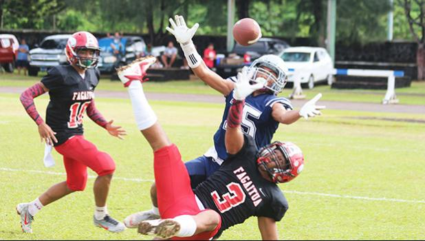 Samoana Sharks Allen Seagai (15) concentrates on trying to catch this long pass from Viliamu Tanielu,