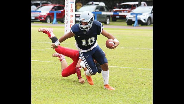 Samoana Sharks Toeaso Sola shakes off a defender