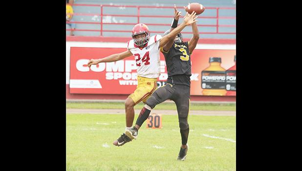 Calloway Alosio (3) of the Nu'uuli Wildcats going up for a grab