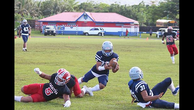 Johnson Talauega intercepting a pass from Fitu Amata of