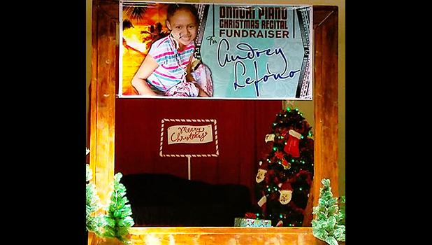 A banner with the photo of 10-year-old Audrey Lefono