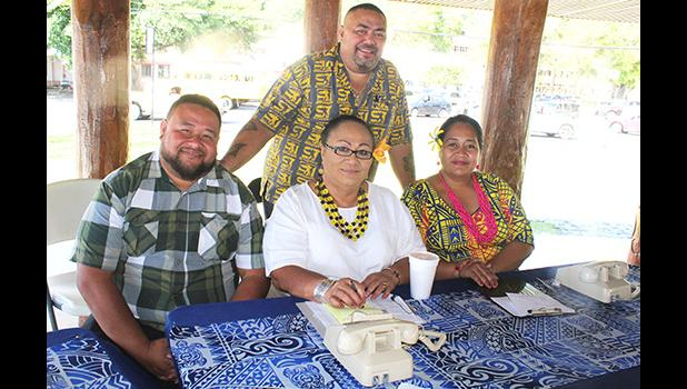 Taupau Tauleave Toluono (standing) along with ASG personnel