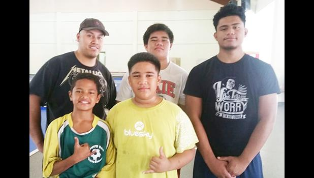 Aspiring wrestlers from around the territory were at the DYWA Pago Pago Community Youth Center yesterday morning to take advantage of the free wrestling clinics being conducted by Alex Ramirez (back row far left), an educator and high school wrestling coach from southern California.  [photo: Blue Chen-Fruean]