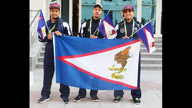 Team AS Wrestlers, Iafeta Vou, Danieal Misaalefua, Nolan Puletasi with the American Samoa Flag on their way over to the wrestling arena for the first matches of the day. Puletasi and Misaalefua were able to advance to wrestle for the bronze medal in their respective categories but both lost in the end. (Photo: Terry Custodio Auva'a)