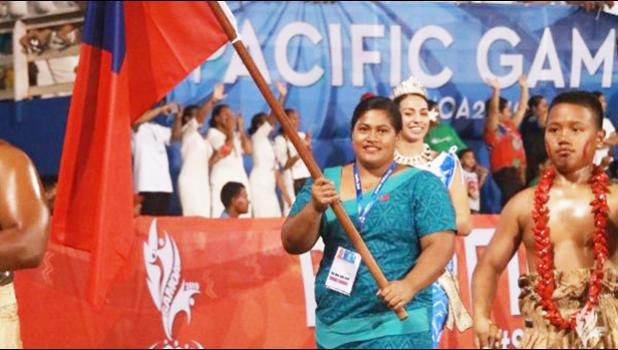 Samoan weightlifter Feagaiga Stowers carrying Samoa flag